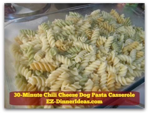 30-Minute Chili Cheese Dog Pasta Casserole - Transfer cooked pasta into a casserole dish