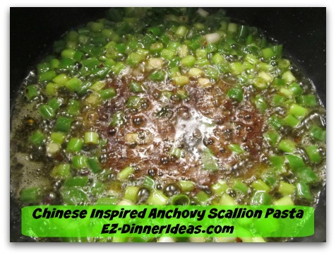 Chinese Inspired Anchovy Scallion Pasta - Stir in dark soy sauce last to keep scallion in vibrant color