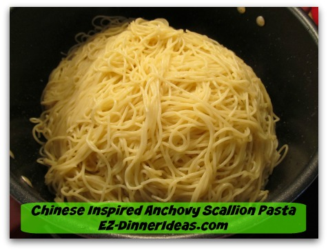 Chinese Inspired Anchovy Scallion Pasta - Toss to coat angel hair pasta