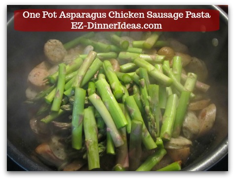 Chicken Sausage Recipe | One Pot Asparagus Chicken Sausage Pasta - Add asparagus spears into the skillet with the chicken sausage.