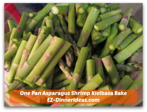 One Pan Asparagus Shrimp Kielbasa Bake - Cut trimmed asparagus spears into thirds