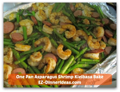 One Pan Asparagus Shrimp Kielbasa Bake is a great alternative for a fish dinner with very little prep work.  Everybody eats with their hands = no dishes.  Is it awesome or what?!