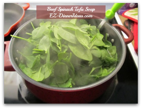 Beef Spinach Tofu Soup - When soup is boiling again, add spinach