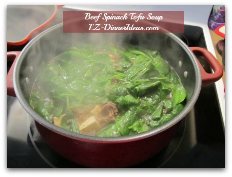 Beef Spinach Tofu Soup - Press spinach into the soup and wilt