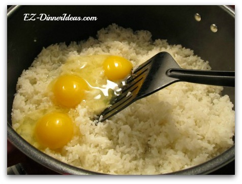 Eggs added on top of the hot rice to make best fried rice dishes