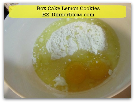 Lemon Cake Mix Cookies - Combine cake mix, oil, lemonade powder mix and eggs in a mixing bowl