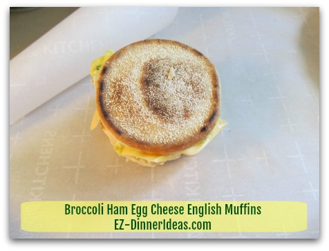 Broccoli Ham Egg Cheese English Muffins - Wrap each sandwich individually with parchment paper - step 1