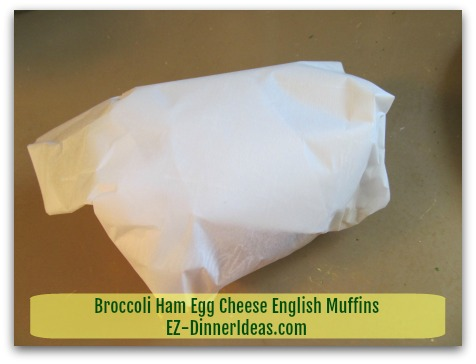 Broccoli Ham Egg Cheese English Muffins - Wrap each sandwich individually with parchment paper - step 3