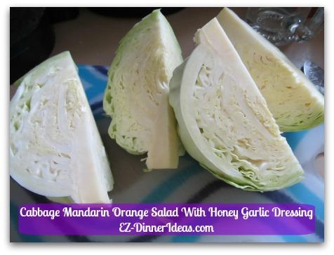Cabbage Mandarin Orange Salad With Honey Garlic Dressing - Cut cabbage into quarters
