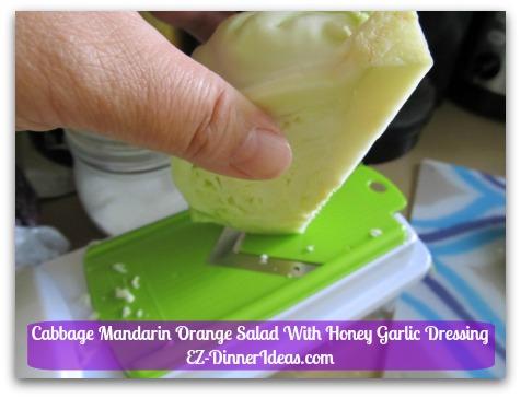 Cabbage Mandarin Orange Salad With Honey Garlic Dressing - Cut side faces opposite direction of the mandolin's blade