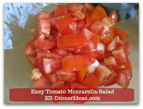 Caprese Salad Recipe | Easy Tomato Mozzarella Salad - Cut tomatoes into bite size.
