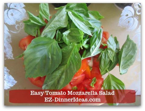 Caprese Salad Recipe | Easy Tomato Mozzarella Salad - Add a few pieces of fresh basil leaves into salad.
