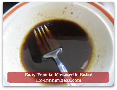 Caprese Salad Recipe   Easy Tomato Mozzarella Salad - Whisk in extra virgin olive oil to make vinaigrette.