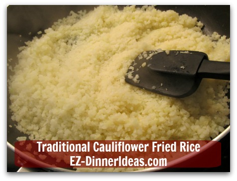 Traditional Cauliflower Fried Rice - Cook frozen cauliflower rice to thaw in a non-stick skillet