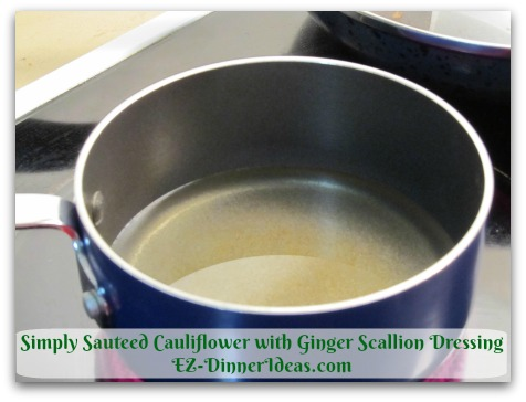 Simply Sauteed Cauliflower with Ginger Scallion Dressing - Heat 1 cup Canola Oil at high heat until it bubbles