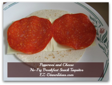 Pepperoni and Cheese No-Fry Breakfast Snack Taquitos - Skipped the sauce in the taquitos because I wanted to stay away from the mess.  Highly recommend you to use sauce for dipping only.