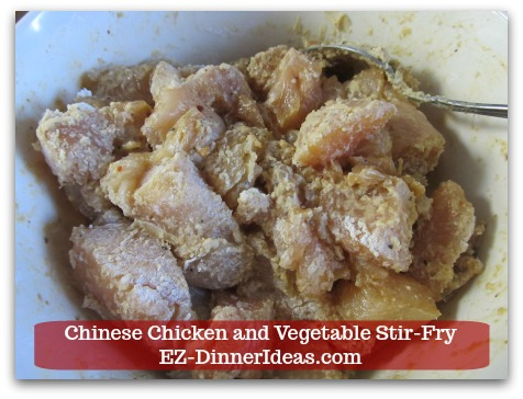 Chicken Stir-Fry Recipe | Chinese Chicken and Vegetable Stir-Fry - Toss to coat chicken with coating mixture.