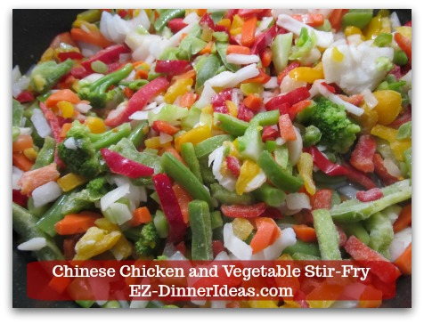 Chicken Stir-Fry Recipe | Chinese Chicken and Vegetable Stir-Fry - Add frozen stir-fried vegetables into the same skillet.