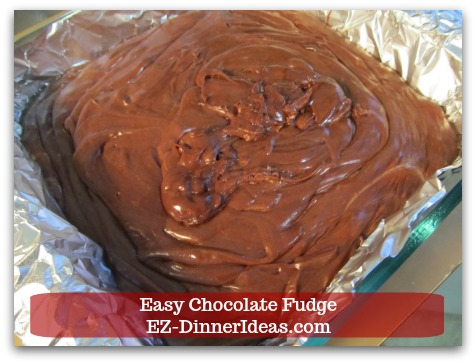 Easy Chocolate Fudge - Transfer fudge to the foil lined baking pan.