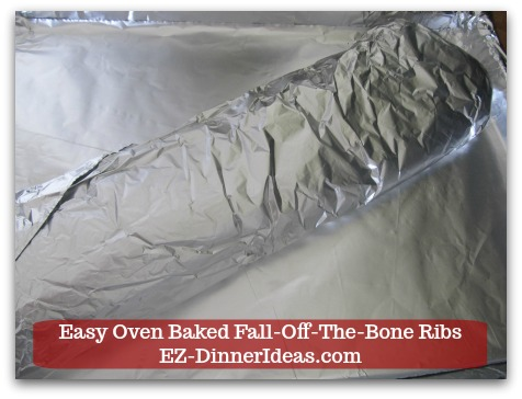 Baby Back Pork Ribs Recipe | Easy Oven Baked Fall-Off-The-Bone Ribs - Transfer the foil covered baby back ribs to the baking sheet and meat side up.