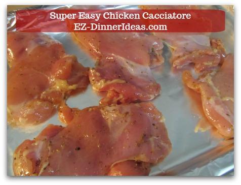 Italian Chicken Dinner Recipe | Super Easy Chicken Cacciatore - Single layer chicken on a foil lined baking sheet.
