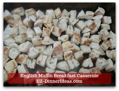 English Muffin Breakfast Casserole - Single layer muffin pieces at the bottom of a casserole dish.