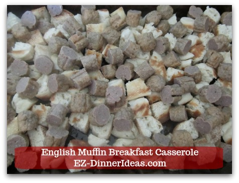 English Muffin Breakfast Casserole - Evenly spread sausage on top of muffin pieces.