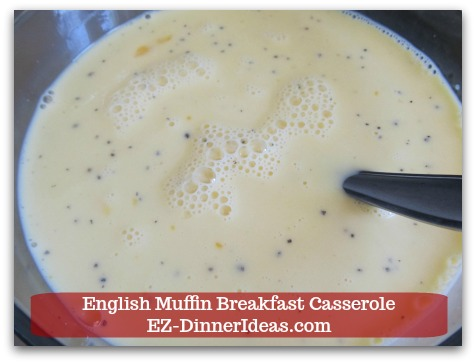 English Muffin Breakfast Casserole - Whisk to combine egg mixture.