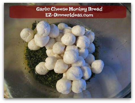 Garlic Cheese Monkey Bread - Add biscuit dough into the seasoning paste and toss to coat with hands