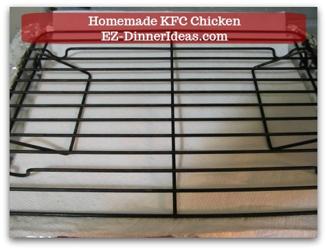 Line a baking sheet with aluminum foil, paper towel and cookie/turkey rack on top. This setup helps on easy cleaning and keep chicken crispy all the way around.
