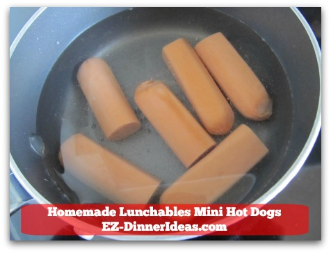 Homemade Lunchables Mini Hot Dogs - In a saucepan with water