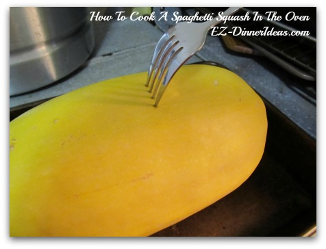 Use a fork to poke several times on the spaghetti squash to let the steam out