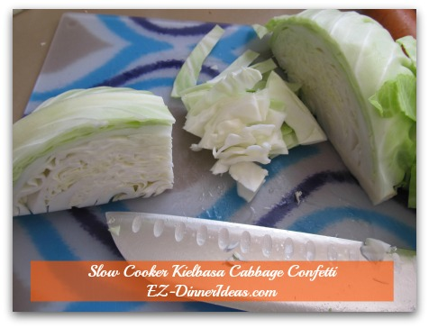 Cabbage Dinner Recipe | Slow Cooker Kielbasa Cabbage Confetti - Core is out.  Turn cabbage 90 degrees.  Cut side faces yourself  to cut against the leaves.