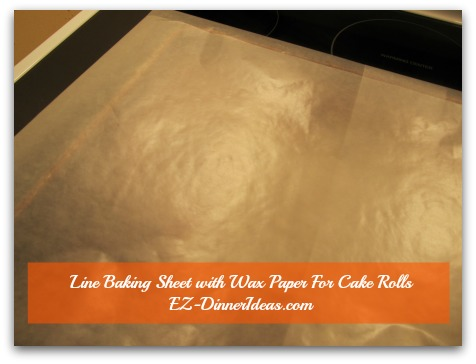 No-Towel Pumpkin Roll - Line the 3rd piece of wax or parchment paper lengthwise on the baking sheet which is on top of the previous 2 pieces of paper