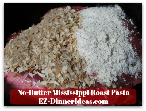 No-Butter Mississippi Roast Pasta - Add chuck roast, onion soup mix and ranch dressing mix into the slow cooker