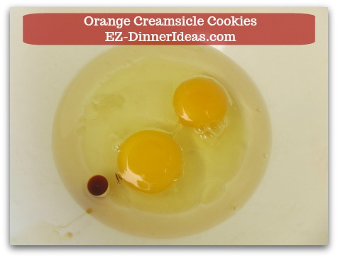 Easy Cake Mix Cookies Recipe | Orange Creamsicle Cookies - Beat 2 eggs, 1/3 cup canola oil and vanilla extract (if you use yellow cake mix) together.