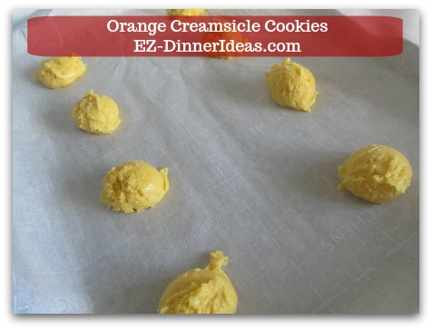 Easy Cake Mix Cookies Recipe | Orange Creamsicle Cookies - Use a small ice-cream scoop and transfer cookie dough to a parchment-paper-lined baking sheet.