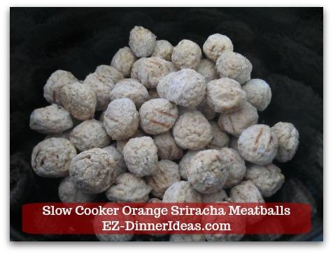 Meatball Finger Food | Slow Cooker Orange Sriracha Meatballs - Add frozen meatballs into a slow cooker.