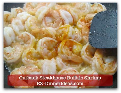 Outback Steakhouse Buffalo Shrimp - Stir in Buffalo sauce.