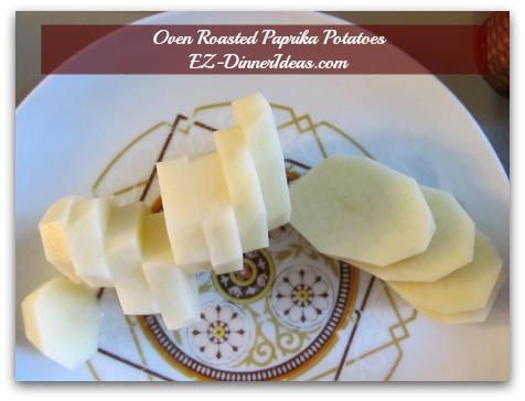 Oven Roasted Paprika Potatoes - Peel and slice potatoes