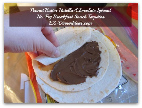 Peanut Butter Nutella/Chocolate Spread No-Fry Breakfast Snack Taquitos - Have either half covered with spread facing you and start rolling towards the other end