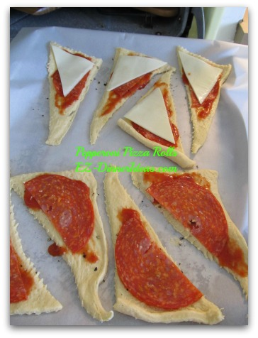 Pepperoni Pizza Rolls - Add sliced Mozzarella or white cheese and pepperoni on top