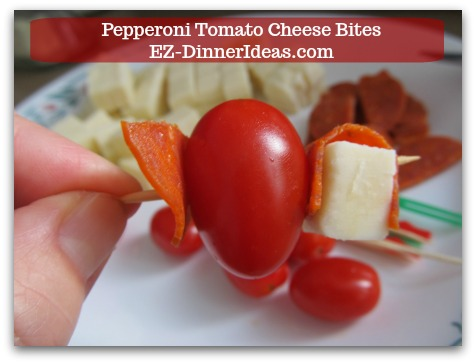 Cheese Finger Food | Pepperoni Tomato Cheese Bites - The layer will be pepperoni, tomato, pepperoni, cheese and pepperoni again.  This guarantees all flavors explode in one bite.