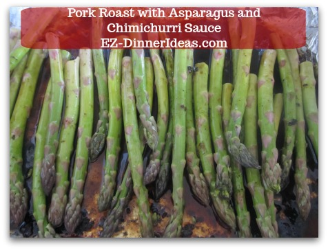 Pork Roast Recipe | Pork Roast with Asparagus and Chimichurri Sauce - While meat is resting, transfer trimmed asparagus into the same roasting pan with dripping.