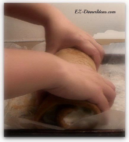 No-Towel Pumpkin Roll - Once the pumpkin roll is formed, apply a little bit of pressure and squeeze the roll lightly to help its shape forming