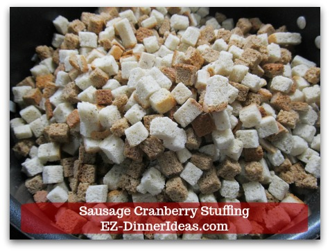 Sausage Cranberry Stuffing Recipe - Stir in stuffing bread cubes.