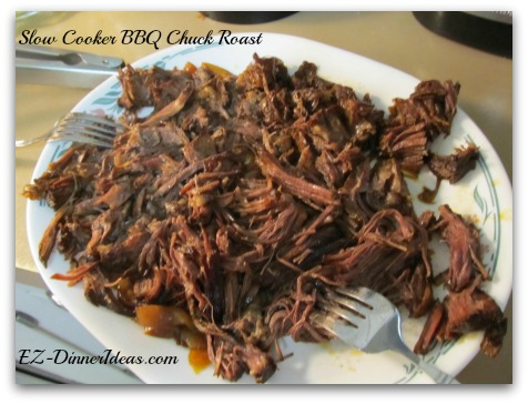 Slow Cooker BBQ Chuck Roast - Use 2 forks to shred the meat and transfer back to the slow cooker