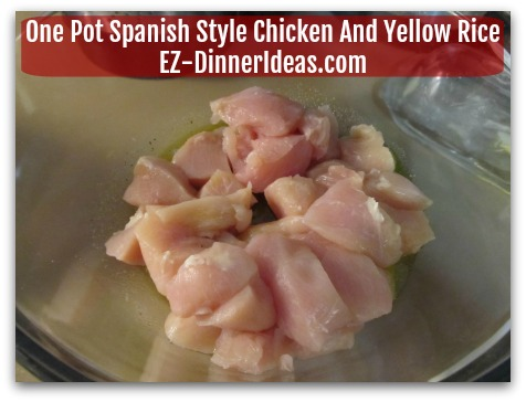One Pot Spanish Style Chicken And Yellow Rice - Add chicken into the bowl with marinade