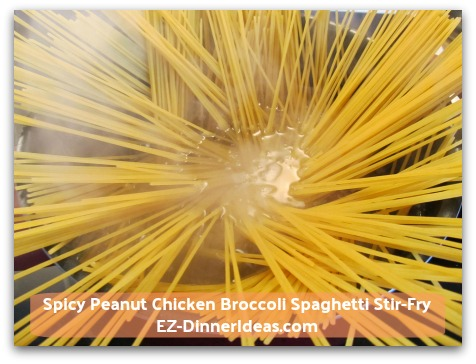 Spicy Peanut Chicken Broccoli Spaghetti Stir-Fry - Keep the same pot of boiling water and add pasta