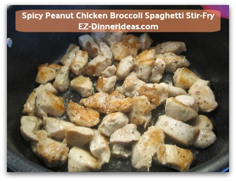Spicy Peanut Chicken Broccoli Spaghetti Stir-Fry - Turn chicken over and cook for another 3 minutes at medium high heat